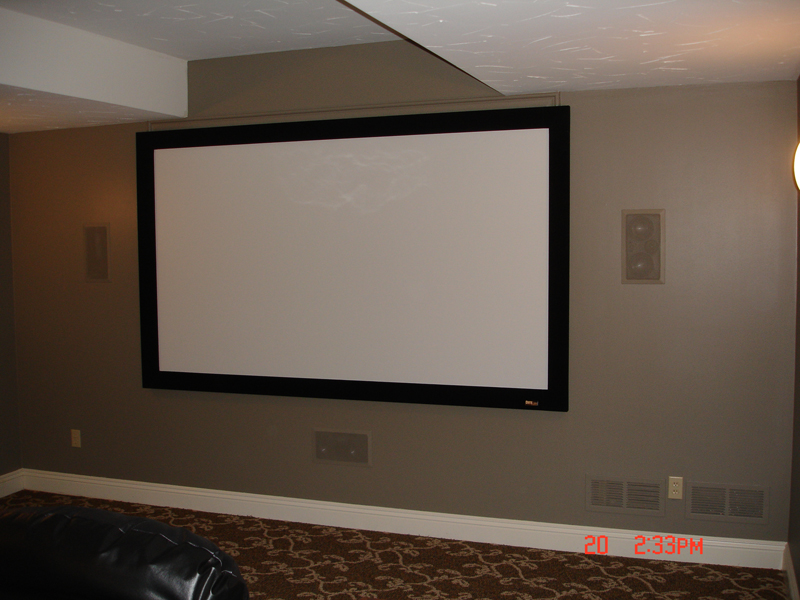 A 106 inch fixed screen with in-wall speakers